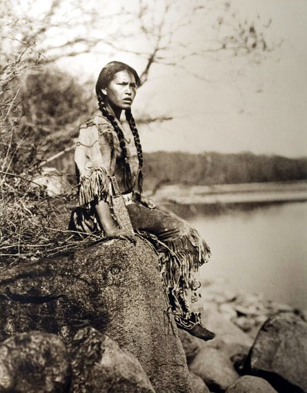 A-Native-American-girl-wearing-a-beaded-buckskin-dress
